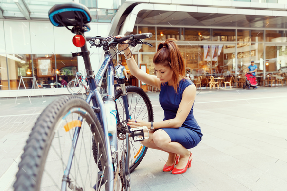 Young woman commuting on bicycle - Stock Photo - Images
