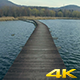 Flying Above The Lake With Wood Bridge - VideoHive Item for Sale