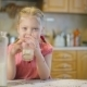 Little Girl Pouring Milk And Drinkig. - VideoHive Item for Sale