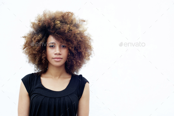 Young african woman with curly hair - Stock Photo - Images