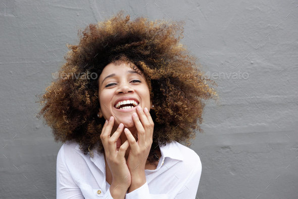 Laughing young woman with afro hair - Stock Photo - Images