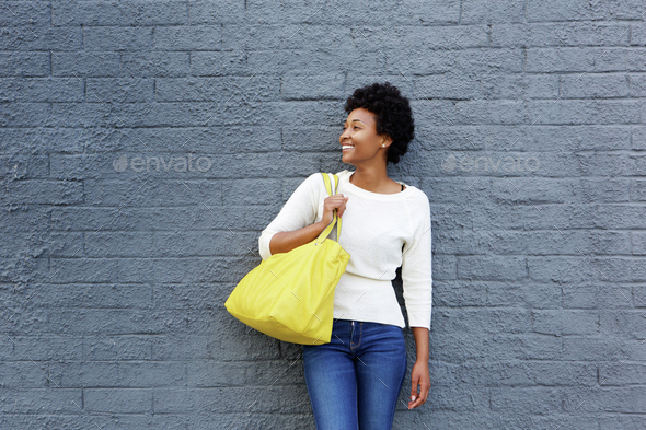 Smiling african woman with bag - Stock Photo - Images