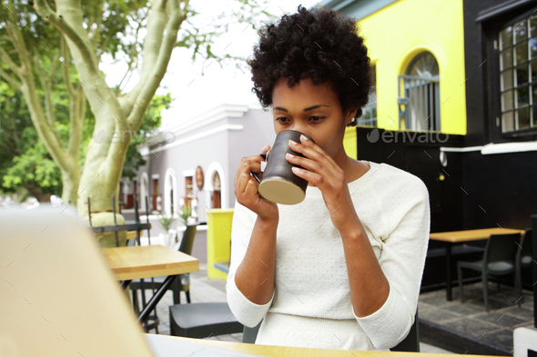 Young african woman drinking cup of tea - Stock Photo - Images