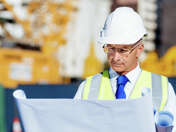 Engineer builder at construction site - Stock Photo - Images