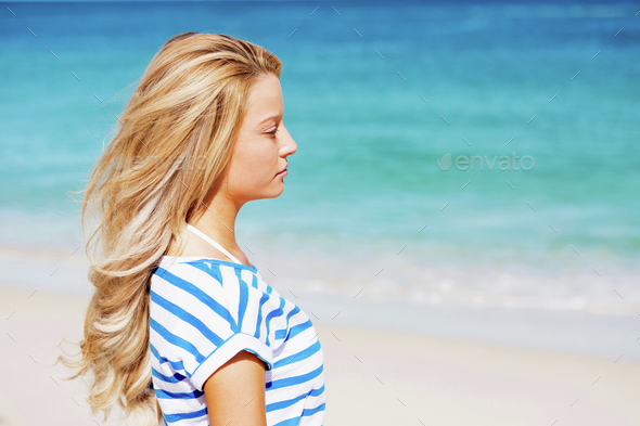 Young woman relaxing on the beach - Stock Photo - Images