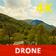 Aerial View of a Beautiful Valley and Mountains in a Sunny Day - VideoHive Item for Sale