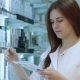 Young Female Pharmacist Selecting a Medication - VideoHive Item for Sale