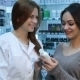 Pharmacist And Female Customer Reading Part - VideoHive Item for Sale