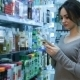 Woman At Pharmacy Buying Shampoo - VideoHive Item for Sale