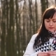 Sad Girl Sniffs And Touches Snowdrops In Spring Forest - VideoHive Item for Sale