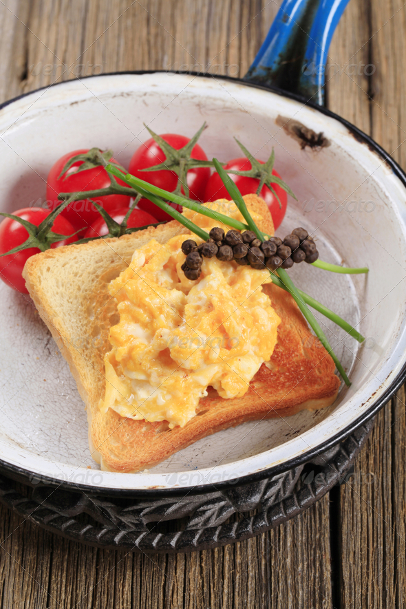 Scrambled eggs on toast - Stock Photo - Images