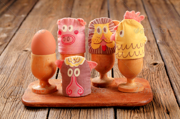 Funny egg cosies for boiled eggs - Stock Photo - Images