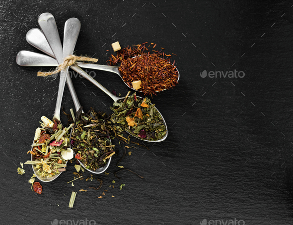 Flavoured and flower tea in metal spoon - Stock Photo - Images