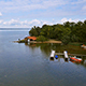 Aerial Footage of a Lake with Boat House - VideoHive Item for Sale