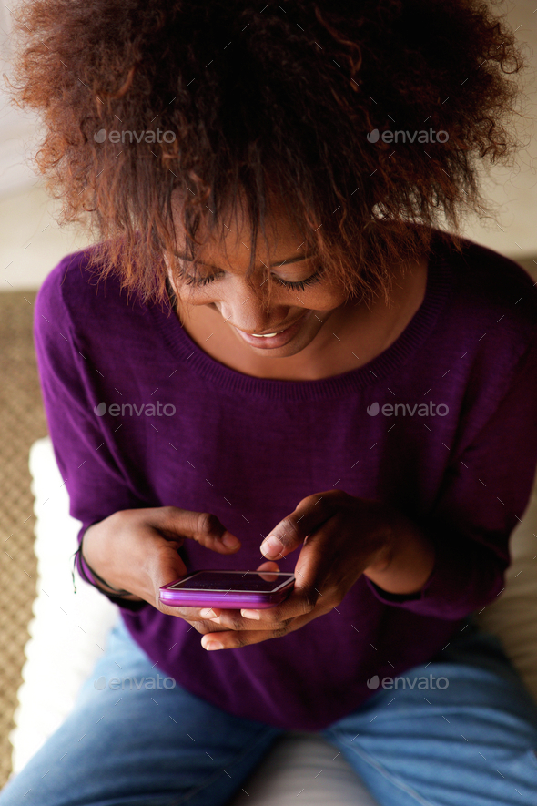 Young woman using mobile phone - Stock Photo - Images