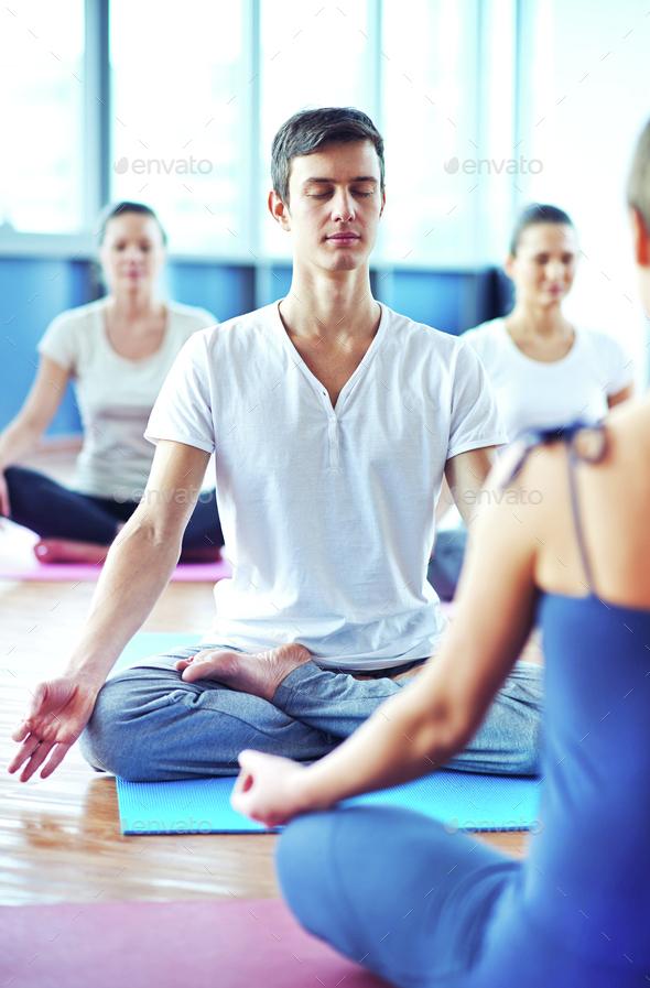 Man meditating - Stock Photo - Images