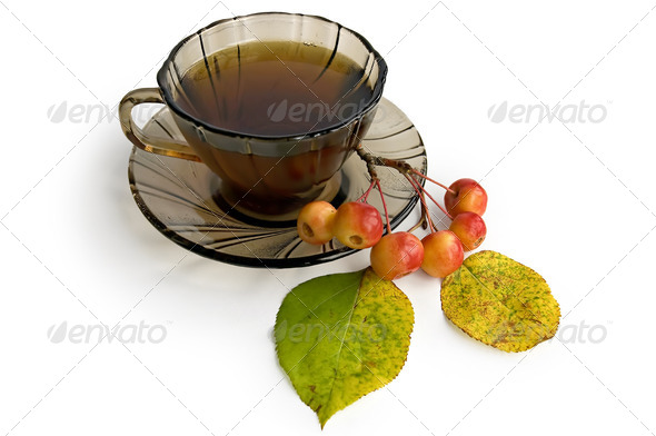 Tea in a brown glass bowl with apples - Stock Photo - Images