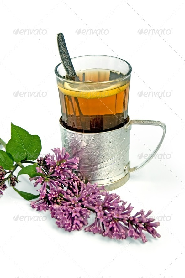 Tea in a glass with lilac - Stock Photo - Images