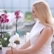Woman Choosing Orchid In Flower Shop - VideoHive Item for Sale