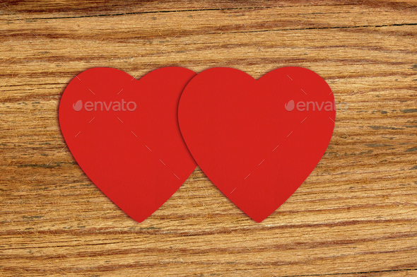 Red felt hearts on wooden background - Stock Photo - Images