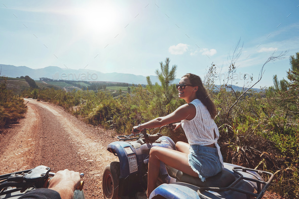 Young woman driving all terrain vehicle in nature - Stock Photo - Images
