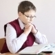 Boy With Glasses Reading a Book  - VideoHive Item for Sale