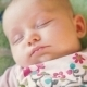 Precious Newborn Baby Is Laying On a Comfortable Bed, Sleeping Peacefully - VideoHive Item for Sale