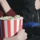 Hand Holding a Bucket Of Popcorn - VideoHive Item for Sale