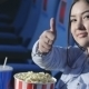Asian Girl Showing a Thumbs Up At The Cinema - VideoHive Item for Sale