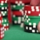 Red Dice And Casino Chips In Fingers On Green Table - VideoHive Item for Sale