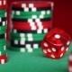 Red Dice Rolls And Casino Chips On Green Table - VideoHive Item for Sale
