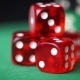 Red Dice And Casino Chips Rotation On Green Table - VideoHive Item for Sale