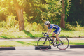 Female cyclist rides a racing bike on road - PhotoDune Item for Sale