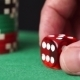 Red Dice And Casino Chips In Hand On Green Table - VideoHive Item for Sale