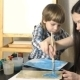 Mom And Kid Boy Painting Together At Home - VideoHive Item for Sale