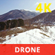 Flying over Snowy Mountains in a Sunny Day - VideoHive Item for Sale
