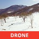 Aerial View of a Snowy Valley in a Sunny Day - VideoHive Item for Sale