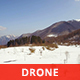 Aerial View of Snowy Mountains in a Sunny Day - VideoHive Item for Sale