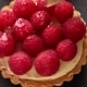 Unfinished To Eat Tartlet With Custard And Fresh Ripe Raspberries And Brush For Glazing Over Gray - VideoHive Item for Sale
