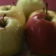 Footage Of Fresh And Wet Green And Red Mixed Apples Lie On a Wooden Board  Which Is Spinning Around - VideoHive Item for Sale