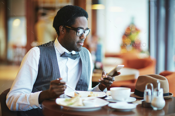 Having lunch in cafe - Stock Photo - Images