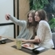 Two Girls Taking Selfies In Japanese Restaurant - VideoHive Item for Sale