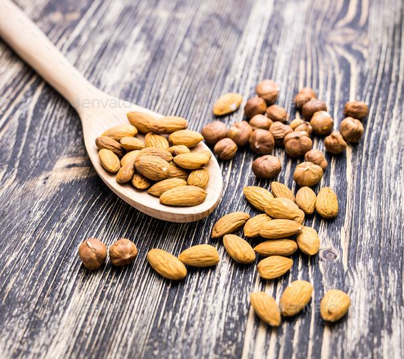 Almonds on wooden background - Stock Photo - Images