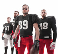 The four american football players posing with ball on white background - PhotoDune Item for Sale