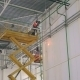 Welder Works On The Orange Lift At a Height In Large And Modern Industry Warehouse - VideoHive Item for Sale
