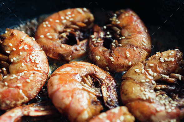 Shrimp fried with garlic and sesame seeds - Stock Photo - Images