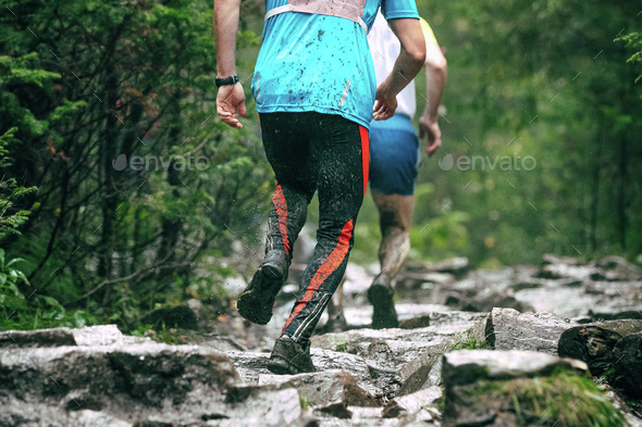 runners climb uphill - Stock Photo - Images