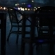 Empty Tables In The Bar On The Waterfront With People Passing In The Background - VideoHive Item for Sale