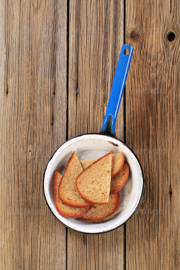 Toasted bread in a pan - Stock Photo - Images