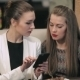 Two Young Businesswomen Meet In Restaurant - VideoHive Item for Sale